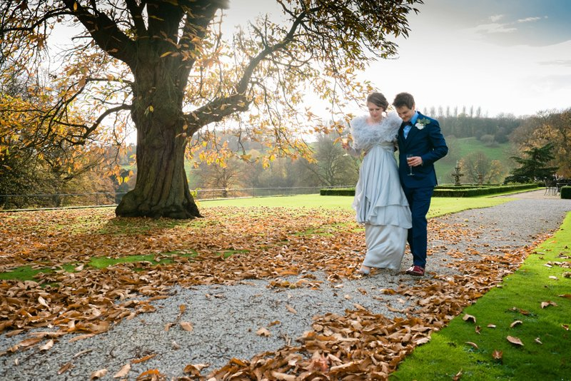 wedding photographers at Hassop Hall in Derbyshire. A romantic scene with the bride and groom taking time out for their relaxed wedding photographs
