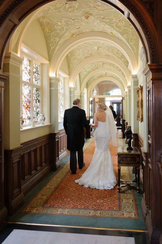 Bride walking with father to her wedding