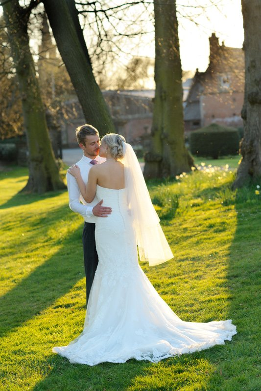Wedding photography of bride and groom in evening sunshine