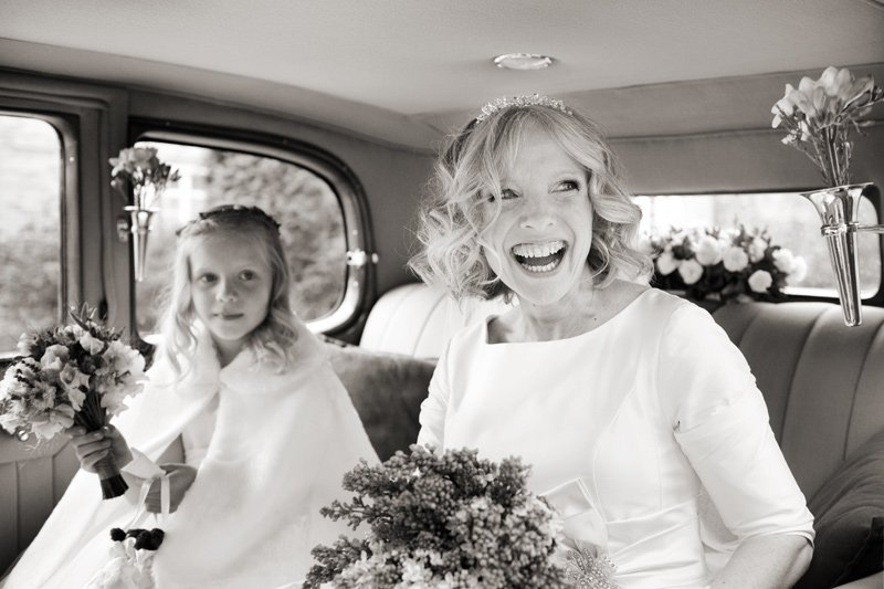Bride arrives at her Derbyshire wedding. Black and white wedding photograph