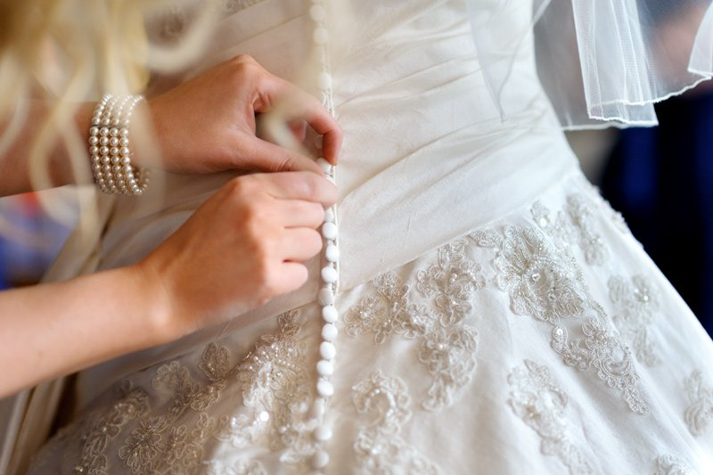 Wedding dress being tied at Kenwood Hall in Sheffield