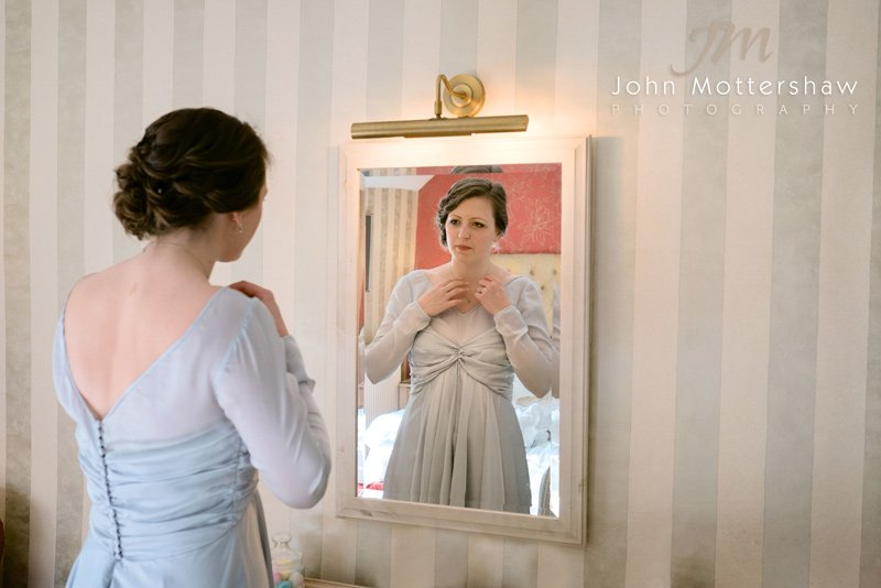 Bride getting ready at the Hathersage Inn, near Sheffield