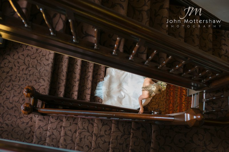 bride on staircase. Wedding photography at the Maynard in Grindleford, near Sheffield