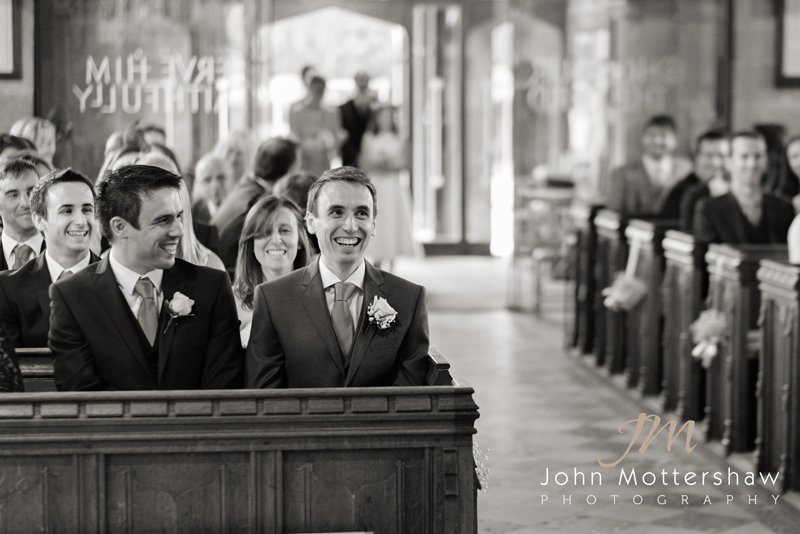 Wedding photography at Duffield Church in Derbyshire. Groom awaiting his bride