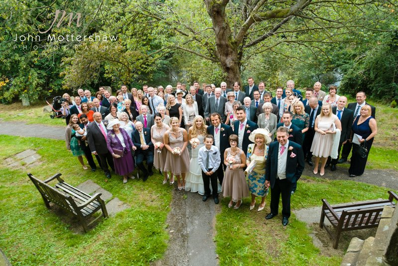 wedding photographers in Derbyshire at Baslow Church. Full group shot