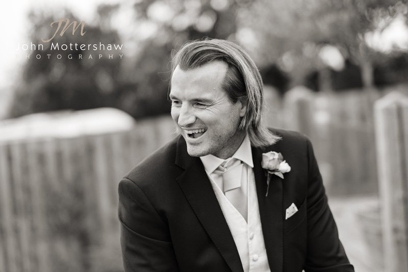 Black & white wedding photograph with humour and fun at Peak Edge Hotel in Derbyshire