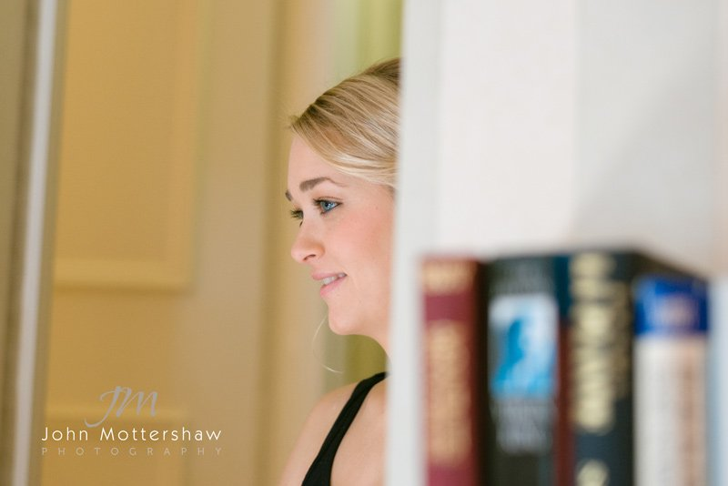 bridesmaid getting ready. Wedding photographer at Hathersage Church