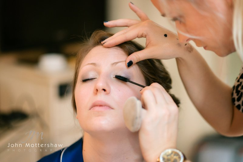bridal make up and getting ready at the George Hotel in Hathersage. Wedding photography at Hathersage Church