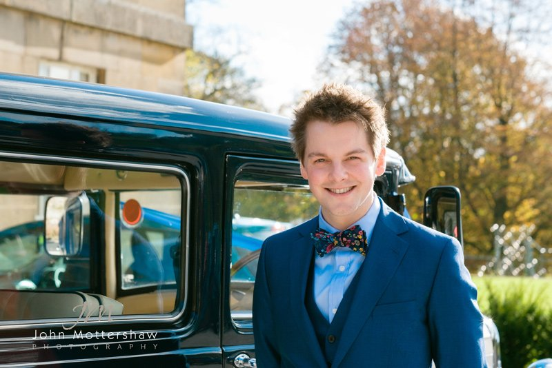wedding photography of Groom arriving at Hassop Hall in Derbyshire