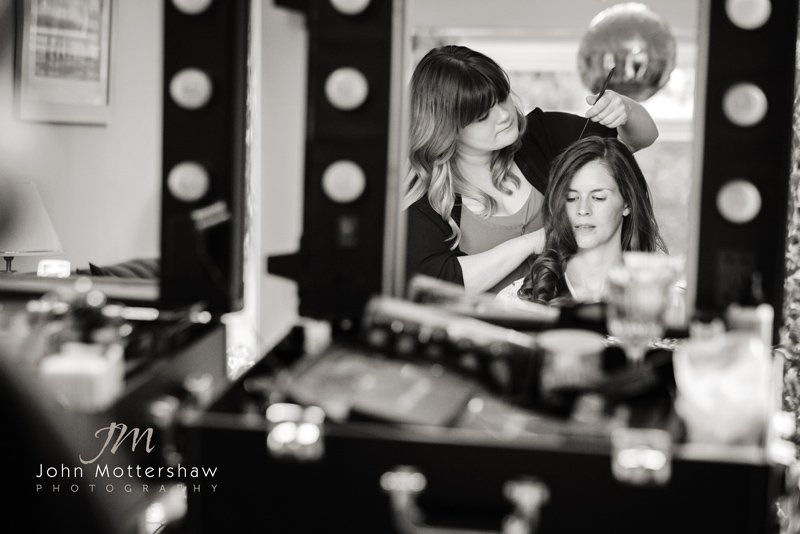 wedding photographer at Hassop Hall. Bride getting ready at home